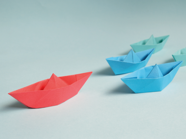 Paper boats, one leading the pack