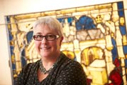 Sarah Brown in front of preserved stained glass (Image: John Houlihan)