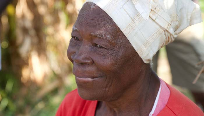 Photo of an older Jamaican woman wearing a headwrap.