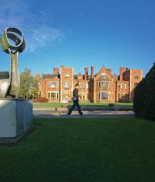 Student walking by Heslington Hall