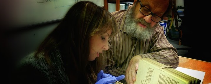 Sarah Fiddyment and Jiri Vnoucek examine a 12th C volume
