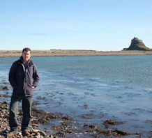 snapshot taken on lindisfarne beach, castle in background