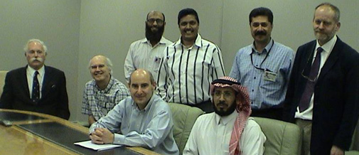 Geoff Bailey, Nic Flemming and Abdullah Alsharekh with Saudi ARAMCO staff at their Dharran headquarters, 2005