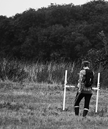 Hayley Saul doing magnetometry at Torpel Manor, Cambs, Sept 2013. Project directed by Steve Ashby and Aleks McClain