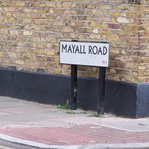 Street names now serve as markers and literal sign-posts to memories of the riots in 1981.