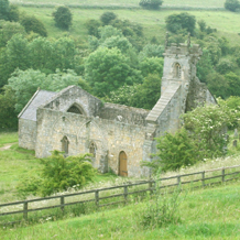 Wharram Percy church in its valley