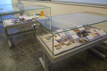 The smaller showcases illustrated aspects of our history over the past 60 years. In the foreground: 'Archives and the Wider Community'