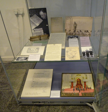 The second showcase focused on Rev J S Purvis, our first Director. At the bottom: his OBE certificate and his sketch of the scene at Buckingham Palace when he received his OBE in 1958