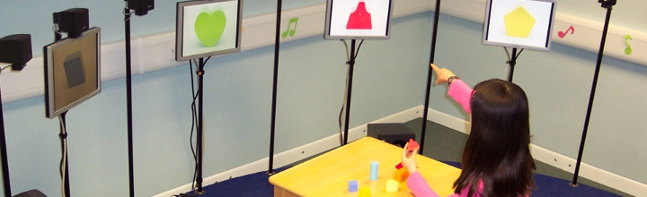 Child performing a task of sound localisation in loudspeaker 'Crescent of Sound'