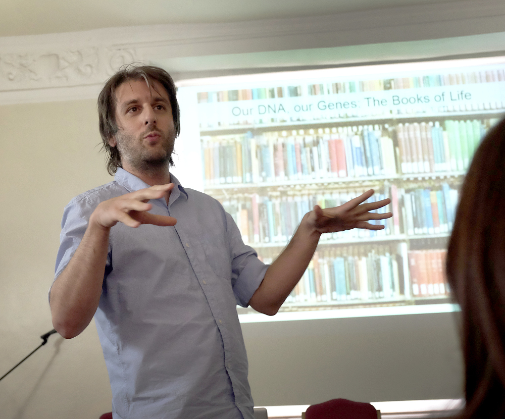 Image: Dr Dimitris Lagos talking about the science that inspired the poetry