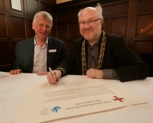 The Lord Mayor of York, Cllr Dave Taylor, signs the York Human Rights City declaration, with Stephen Pittam, chair of the York Human Rights City Steering Group.