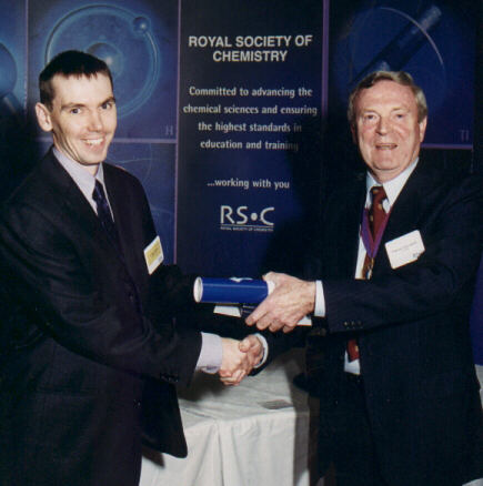 photo of Peter O'Brien receiving the Meldola Medal from Tony Ledwith, President of the RSC