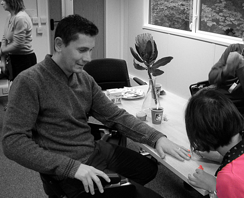 Image: Ian Fairlamb has his nails painted to raise money for breast cancer awareness