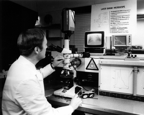 Image: Reuben Girling with laser raman spectrometer