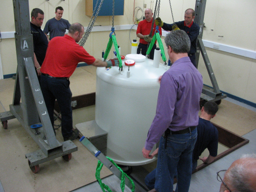 Image: Lowering a Bruker 700MHz magnet into a pit to ensure the magnetic field is safely contained within the room.