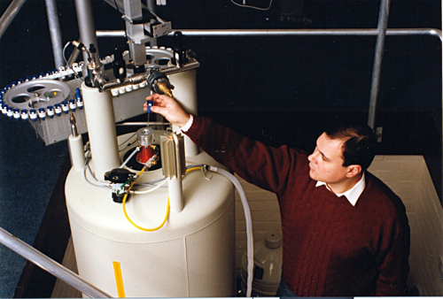 Image: Graham Barlow loading a sample into an NMR spectrometer