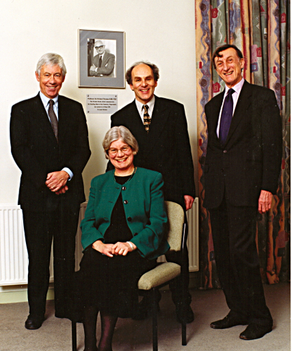Image: Three heads of department, Bruce Gilbert, Robin Perutz and David Waddington with the head of department's secretary Susan Greenhow. The department's first head of department Richard Norman is pictured on the wall in the background.