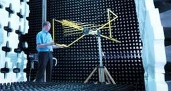 Yellow Bilog antenna in anechoic chamber