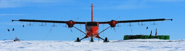 British Antarctic aerogeophysical survey aircraft at Patriot Hills, West Antarctica. Radar antennas used to measure the ice bed morphology visible beneath each wing (Credit: Neil Ross/University of Edinburgh).