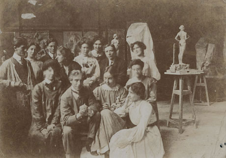 Albert Toft seated in a studio with students, Leeds Museums & Galleries (Henry Moore Institute Archive)