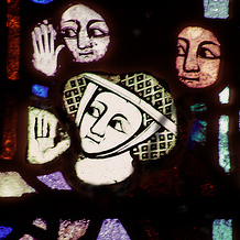 Detail of early 14th Century Penancer's Window showing female penitent, nave of York Minster
