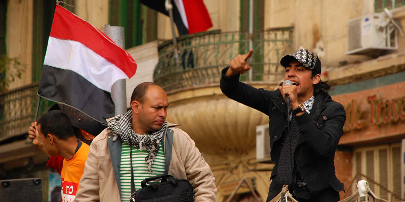 A young man speaks to a group of protesters at Tahrir Square. Cairo, Egypt.