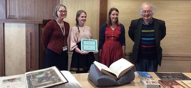 Elizabeth Dunnett, winner of the 2019 Fothergill Book Collecting Prize, receives her prize from the judging panel in front of a display of books from her collection. The three judges shown are Sarah Griffin, Beth Hume and Pete Biller.