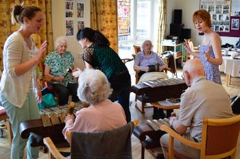 MA Community Music students running a Gamelan session with residents of a local care home.