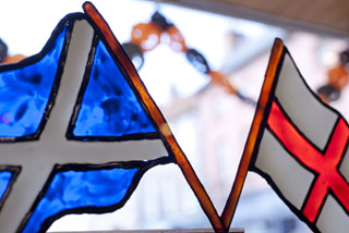 Crossed flags in Berwick bakery window (c) Paul Watt Photography
