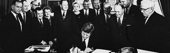 John F Kennedy signing the Fulbright-Hays Act, 1961, enacted to promote mutual understanding between the US and other countries, strengthening earlier legislation. (Far left, Senator Fulbright) Photo source: Fulbright.State.Gov