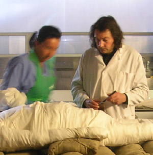 Dr Stephen Buckley applying a resin-based mixture to secure the wrappings of Alan Billis' mummified body, overseen by senior anatomical pathology technician Maxine Coe at Sheffield's Medico-Legal Centre. Photo copyright of the University of York Mummy Research Group/Dr J Fletcher