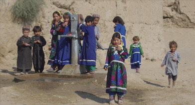 Children at a water pump in Afghanistan
