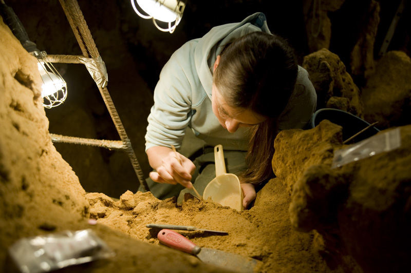 Image: A researcher at work in El Sidrón Cave. Credit: CSIC Comunicación