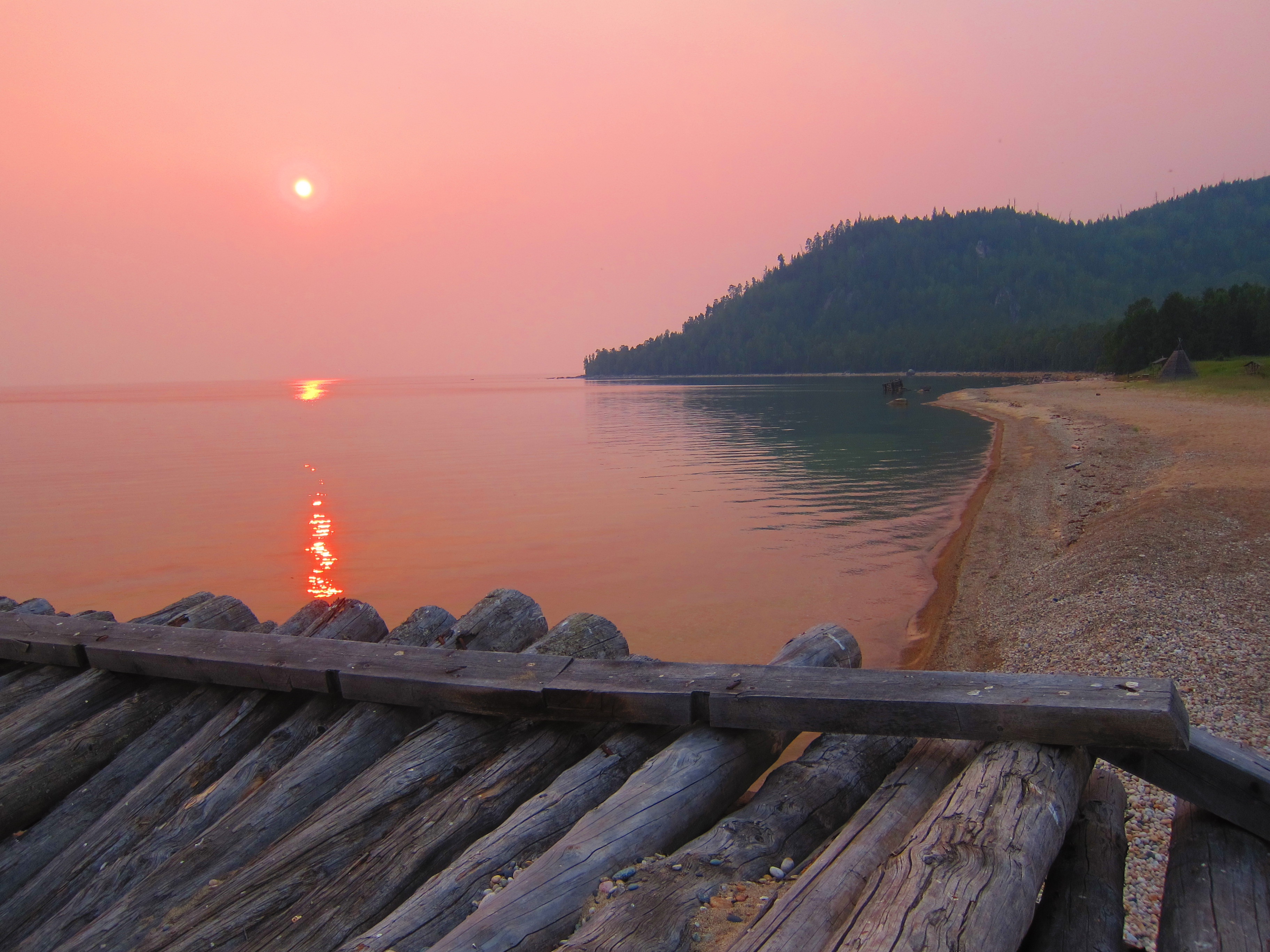 Image: An extraordinary sunset over Lake Baikal - but heightened by the ever present forest fires. Credit: Bryce Stewart