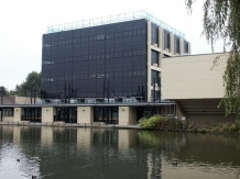 The Physics and Electronics building overlooking the campus lake.