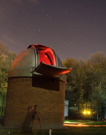 The Dome on Astrocampus at night with a photographer