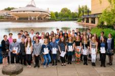 2015 Ogden Awards attendees holding their awards in front of the University of York's lake