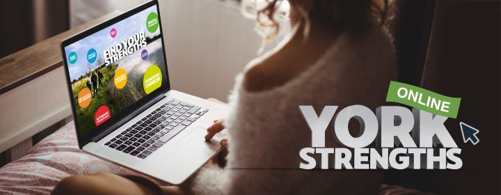 girl sat at computer with York Strengths web page open