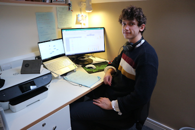 picture of student Theo Holland at a desk