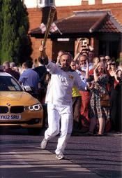 Peter Thompson carrying the Olympic torch