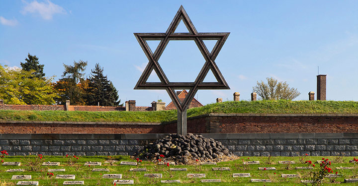 The traditional star of David stands over the memorial graveyard at the Little fortress in Terezin (or Theresianstadt) in the Czech Republic to commemorate the thousands of Jews who died at the Prison camp in World War II (© istock.com/searagen)