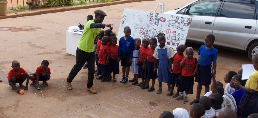 teaching road safety in a Kampala primary school. Pic: Howard Cambridge