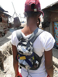 Air quality monitoring in Nairobi - Community member with Dylos backpack