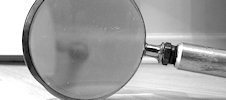 Research - photo of a magnifying glass (cc) flickr.com/photos/nathanmac87/5073480098/