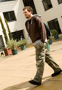 Student walking in the Seebohm Rowntree Building Courtyard