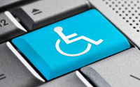 A blue key with a wheelchair disability symbol in a grey keyboard.