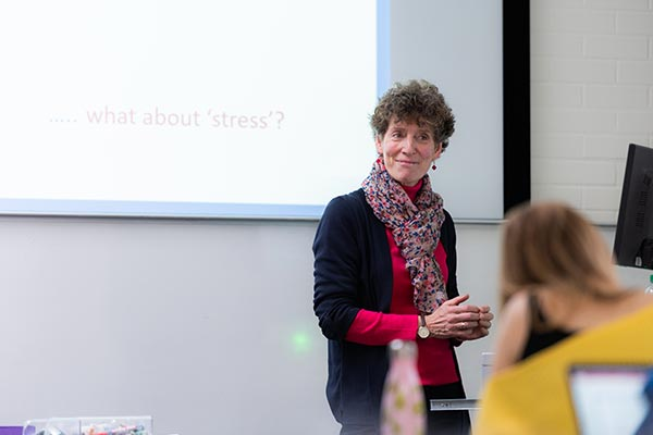 Poppy Nash, a member of staff in the Department of Education, presenting to a group of students.