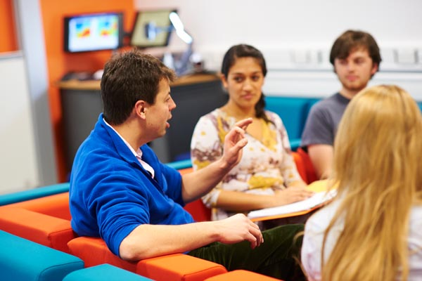 Students talking to a lecturer in the Natural Sciences Learning Studio.